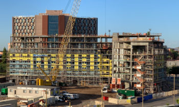 """Mortenson celebrates construction progress with 1st """"Topping Out"""" in Novus Innovation Corridor"""